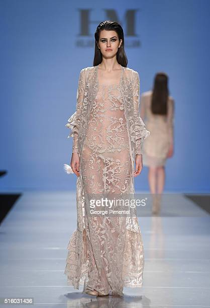 A model walks the runway wearing Hilary Macmillan 2016 collection during Toronto Fashion Week Fall 2016 at David Pecaut Square on March 16 2016 in...