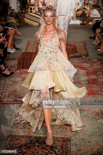 A model walks the runway wearing Houghton Bridal Spring/Summer 2016 at Industria Superstudio on April 18 2015 in New York City