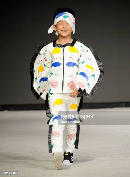 A model walks the runway wearing HUGLAND at 2017 Vancouver Fashion Week Day 6 on September 23 2017 in Vancouver Canada