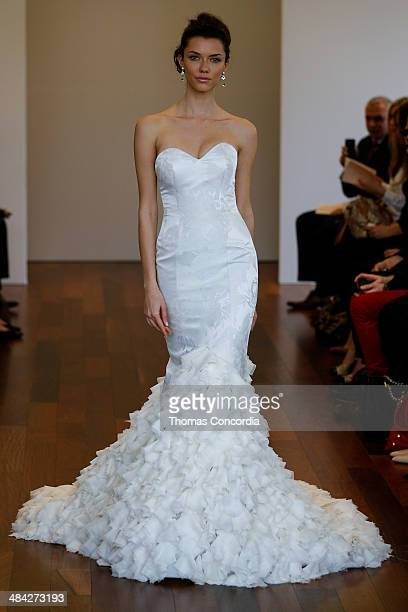 A model walks the runway wearing Isabelle Armstrong Spring 2015 Bridal collection at the Penthouse 45 on April 11 2014 in New York City