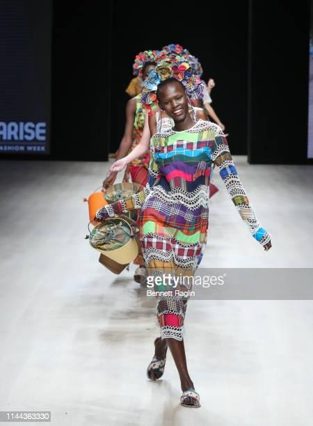 Model walks the runway wearing Ituen Basi during Arise Fashion Week on April 21, 2019 in Lagos, Nigeria.