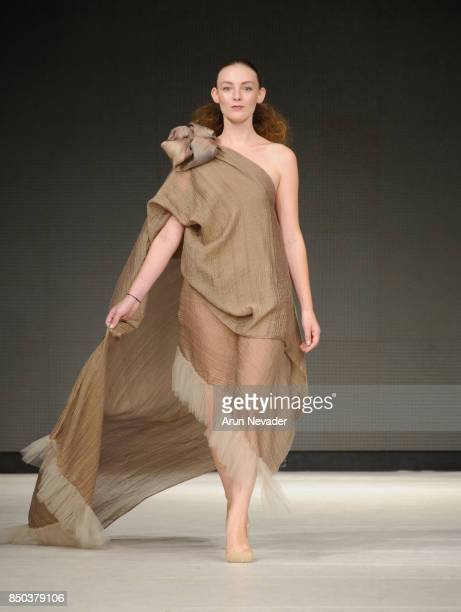 A model walks the runway wearing JAAJ at 2017 Vancouver Fashion Week Day 3 on September 20 2017 in Vancouver Canada