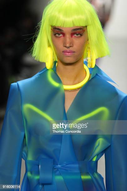 A model walks the runway wearing Jeremy Scott Fall 2018 with make up by Kabuki for MAC and hair by Eugene Souleiman for Wella at Spring Studios on...