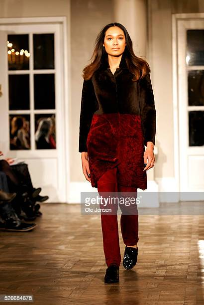 A model walks the runway wearing Jesper Hoevring latest fur collection for women during the Copenhagen Fashion Week Autumn/Winter 2016 This show was...