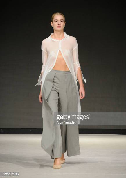 A model walks the runway wearing Jillian Isabell presented by JCI at 2017 Vancouver Fashion Week Day 7 on September 24 2017 in Vancouver Canada
