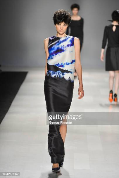 A model walks the runway wearing Joe Fresh fall 2013 collection during World MasterCard Fashion Week Fall 2013 at David Pecaut Square on March 20...