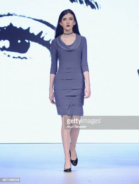 A model walks the runway wearing Joseph Ribkoff during day five of Vancouver Fashion Week Fall/Winter 2017 at Chinese Cultural Centre of Greater...