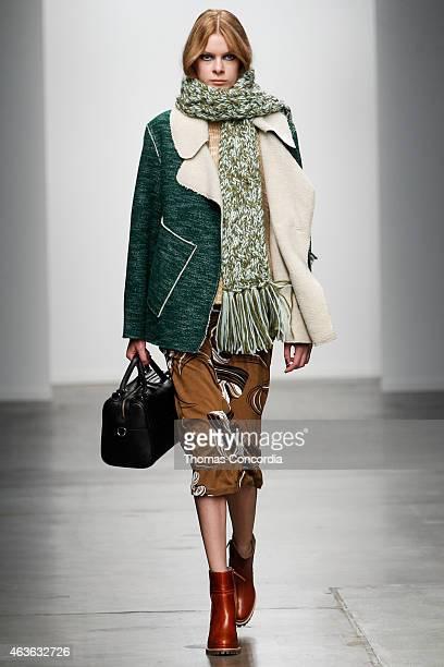 A model walks the runway wearing Karen Walker Fall 2015 during MercedesBenz Fashion Week at Pier 59 on February 16 2015 in New York City