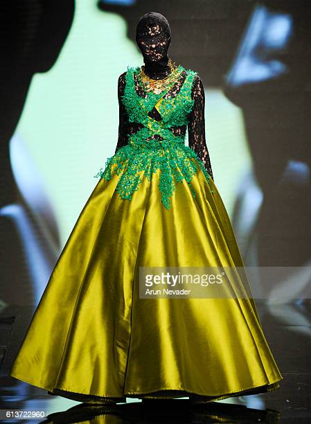 A model walks the runway wearing Kenneth Barlis at Art Hearts Fashion Los Angeles Fashion Week presented by AIDS Healthcare Foundation on October 9...