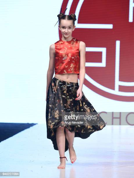 A model walks the runway wearing Kenneth Chow at 2018 Vancouver Fashion Week Day 7 on March 25 2018 in Vancouver Canada