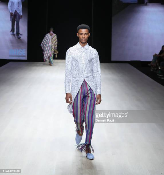 A model walks the runway wearing Kenneth Ize during Arise Fashion WeeK on April 20 2019 in Lagos Nigeria