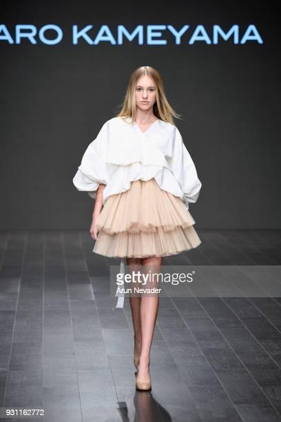 A model walks the runway wearing Kentaro Kameyama at Los Angeles Fashion Week Powered by Art Hearts Fashion LAFW FW/18 10th Season Anniversary at The...