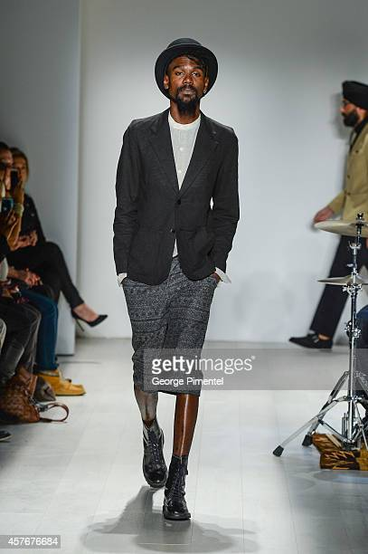 A model walks the runway wearing Klaxon Howl spring 2015 collection during World MasterCard Fashion Week Spring 2015 at David Pecaut Square on...