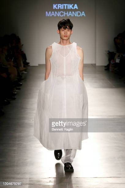 A model walks the runway wearing Kritika Manchanda during the Fashion Institute Of Technology's Fine Art Of Fashion And Technology Show at Pier 59...