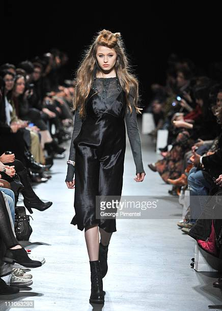 Model walks the runway wearing Label's fall 2011 collection at LG Fashion Week at the Heritage Court, Exhibition Place on March 29, 2011 in Toronto,...