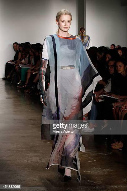 Model walks the runway wearing Lako Bukia's collection at Parsons MFA runway show during MADE Fashion Week Spring 2015 at Milk Studios on September...