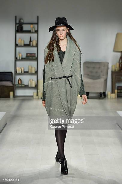 A model walks the runway wearing Laura SiegelÊfall 2014 collection during World MasterCard Fashion Week Fall 2014 at David Pecaut Square on March 18...