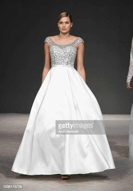 A model walks the runway wearing Lena Kasparian Vancouver Fashion Week Spring/Summer 19 Day 5 on September 21 2018 in Vancouver Canada