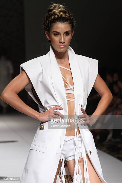 A model walks the runway wearing Lina Cantillo during Colombiamoda 2010 at Plaza Mayor on July 27 2010 in Medellin Colombia