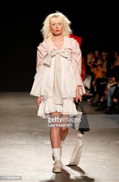 Model walks the runway wearing Linda Zhuang at the University of Westminster BA show during London Fashion Week February 2019 on February 15, 2019 in...