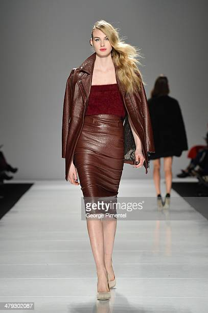 A model walks the runway wearing Line Knitwear fall 2014 collection during World MasterCard Fashion Week Fall 2014 at David Pecaut Square on March 17...