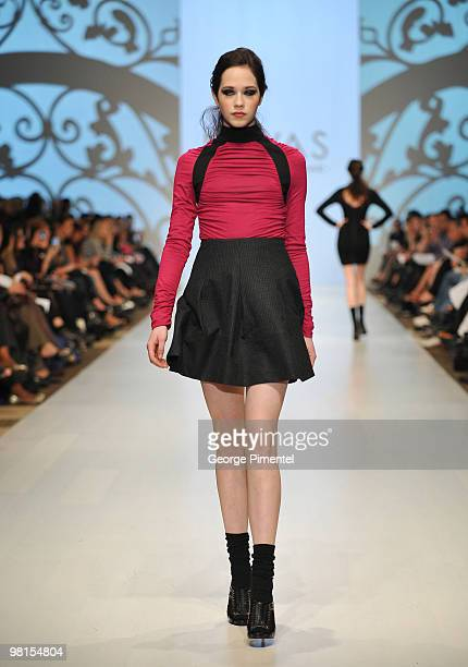 A model walks the runway wearing LOVAS fall 2010 collection at the Allstream Centre on March 30 2010 in Toronto Canada