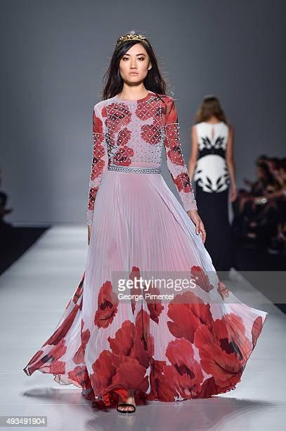 A model walks the runway wearing Lucian Matis spring 2016 collection during World MasterCard Fashion Week Spring 2016 at David Pecaut Square on...