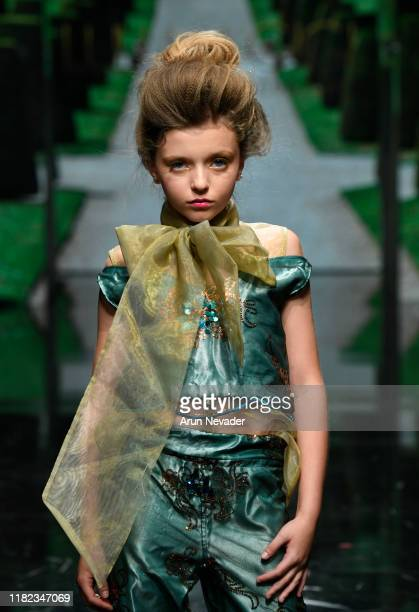 A model walks the runway wearing Lulu Et Gigi during Los Angeles Fashion Week SS/20 Powered by Art Hearts Fashion on October 20 2019 in Los Angeles...