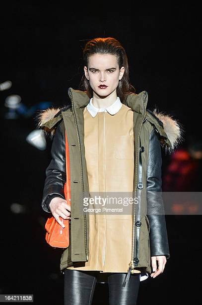 A model walks the runway wearing Mackage fall 2013 collection during World MasterCard Fashion Week Fall 2013 at David Pecaut Square on March 20 2013...