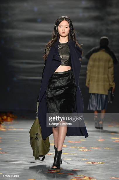 A model walks the runway wearing Mackage fall 2014 collection during World MasterCard Fashion Week Fall 2014 at David Pecaut Square on March 19 2014...