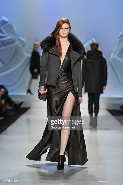 A model walks the runway wearing Mackage fall 2015 collection during World MasterCard Fashion Week Fall 2015 at David Pecaut Square on March 25 2015...