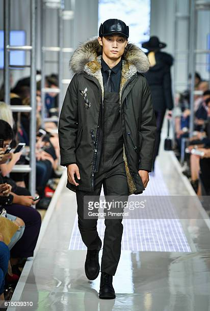 A model walks the runway wearing Mackage Fall 2016 collection during FashionCAN at Yorkdale Shopping Centre on October 16 2016 in Toronto Canada
