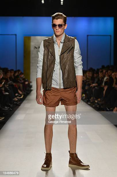 A model walks the runway wearing Mackage spring 2013 collection at at David Pecaut Square on October 24 2012 in Toronto Canada