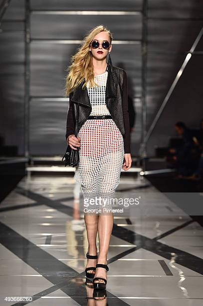A model walks the runway wearing Mackage spring 2016 collection during World MasterCard Fashion Week Spring 2016 at David Pecaut Square on October 21...