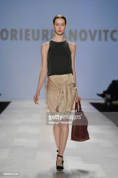 A model walks the runway wearing Malorie Urbanovitch spring 2014 collection during the MercedesBenz StartUp national final at World MasterCard...