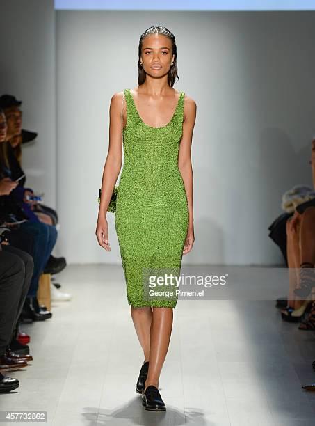A model walks the runway wearing Malorie Urbanovitch spring 2015 collection during World MasterCard Fashion Week Spring 2015 at David Pecaut Square...