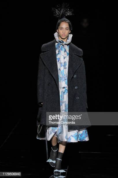 A model walks the runway wearing Marc Jacobs Fall 2019 collection with hair by Guido Palau and makeup by Diane Kendal on February 13 2019 in New York...