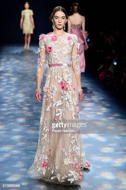 A model walks the runway wearing Marchesa Fall 2016 during New York Fashion Week The Shows at The Dock Skylight at Moynihan Station on February 17...