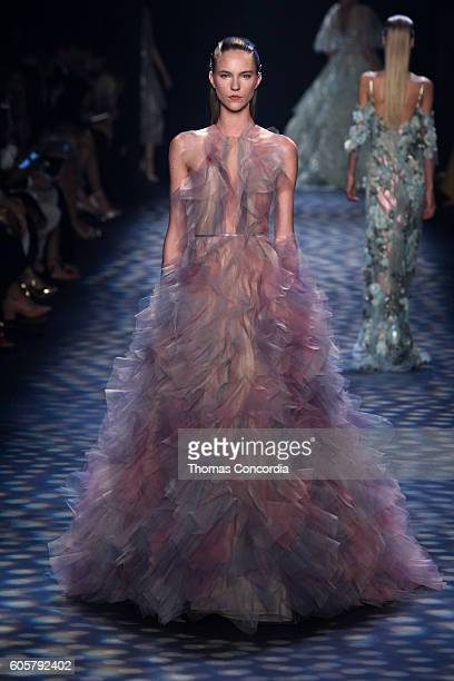 A model walks the runway wearing Marchesa Spring 2017 at The Dock Skylight at Moynihan Station during New York Fashion Week on September 14 2016 in...