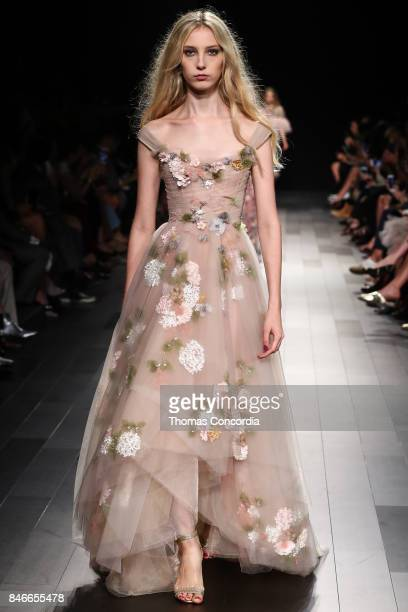 A model walks the runway wearing Marchesa Spring 2018 during New York Fashion Week on September 13 2017 in New York City