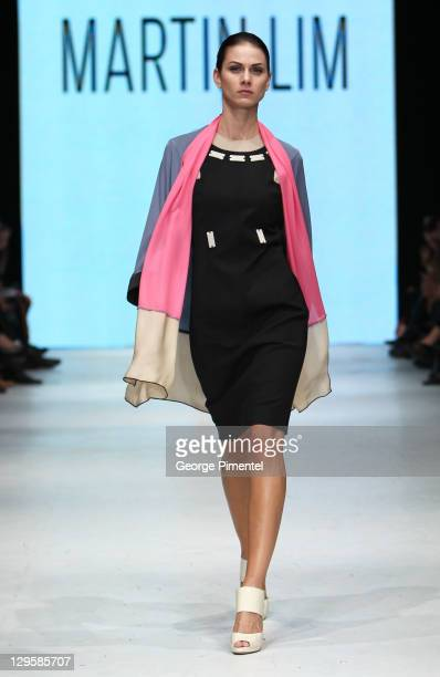 Model walks the runway wearing Martin Lim spring 2012 collection at David Pecaut Square on October 18, 2011 in Toronto, Canada.