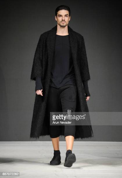 Model walks the runway wearing Mary Ebra during day four of Vancouver Fashion Week Fall/Winter 2017 at Chinese Cultural Centre of Greater Vancouver...