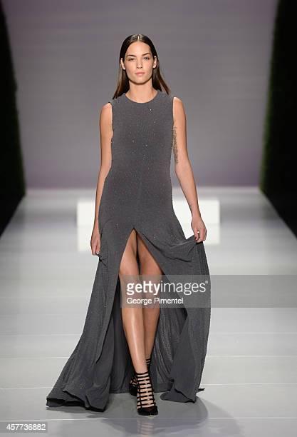 Model walks the runway wearing Matthew Gallagher Spring 2015 Collection during World MasterCard Fashion Week Spring 2015 at David Pecaut Square on...