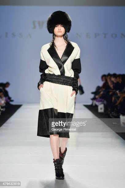 A model walks the runway wearing Melissa Nepton fall 2014 collection during World MasterCard Fashion Week Fall 2014 at David Pecaut Square on March...
