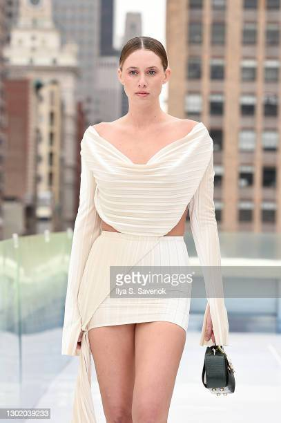 Model walks the runway wearing Mia Cherise Designs, CW Jewels and Luckynelly bags during the Flying Solo show on February 13, 2021 in New York City.