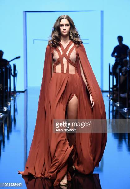 A model walks the runway wearing Michael Costello at Los Angeles Fashion Week Powered by Art Hearts Fashion LAFW SS/19 at The Majestic Downtown on...
