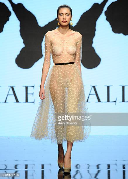 A model walks the runway wearing Michael Wallace at Art Hearts Fashion Los Angeles Fashion Week Presented by AIDS Healthcare Foundation on October 10...
