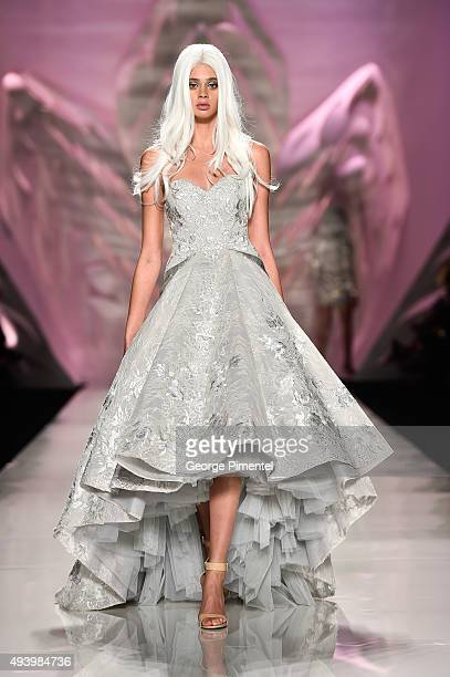 A model walks the runway wearing Mikael D spring 2016 collection during World MasterCard Fashion Week Spring 2016 at David Pecaut Square on October...
