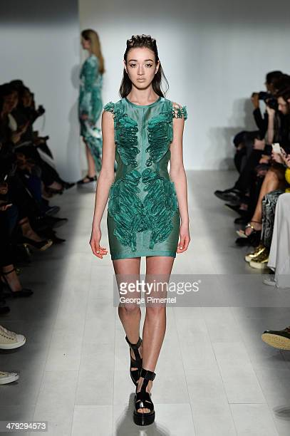 A model walks the runway wearing Mikhael Kale fall 2014 collection during World MasterCard Fashion Week Fall 2014 at David Pecaut Square on March 17...