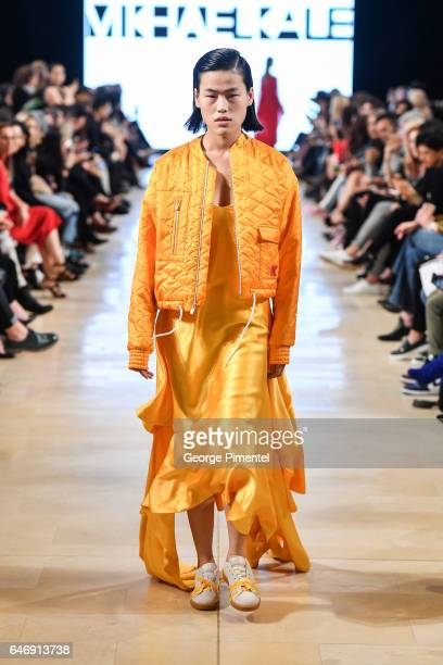 A model walks the runway wearing Mikhael Kale Fall/Winter 2017 at Yorkdale Shopping Centre on March 1 2017 in Toronto Canada